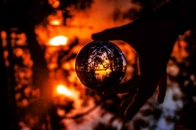 photo of person s hand holding a lensball