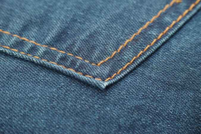photo of blue denim textile