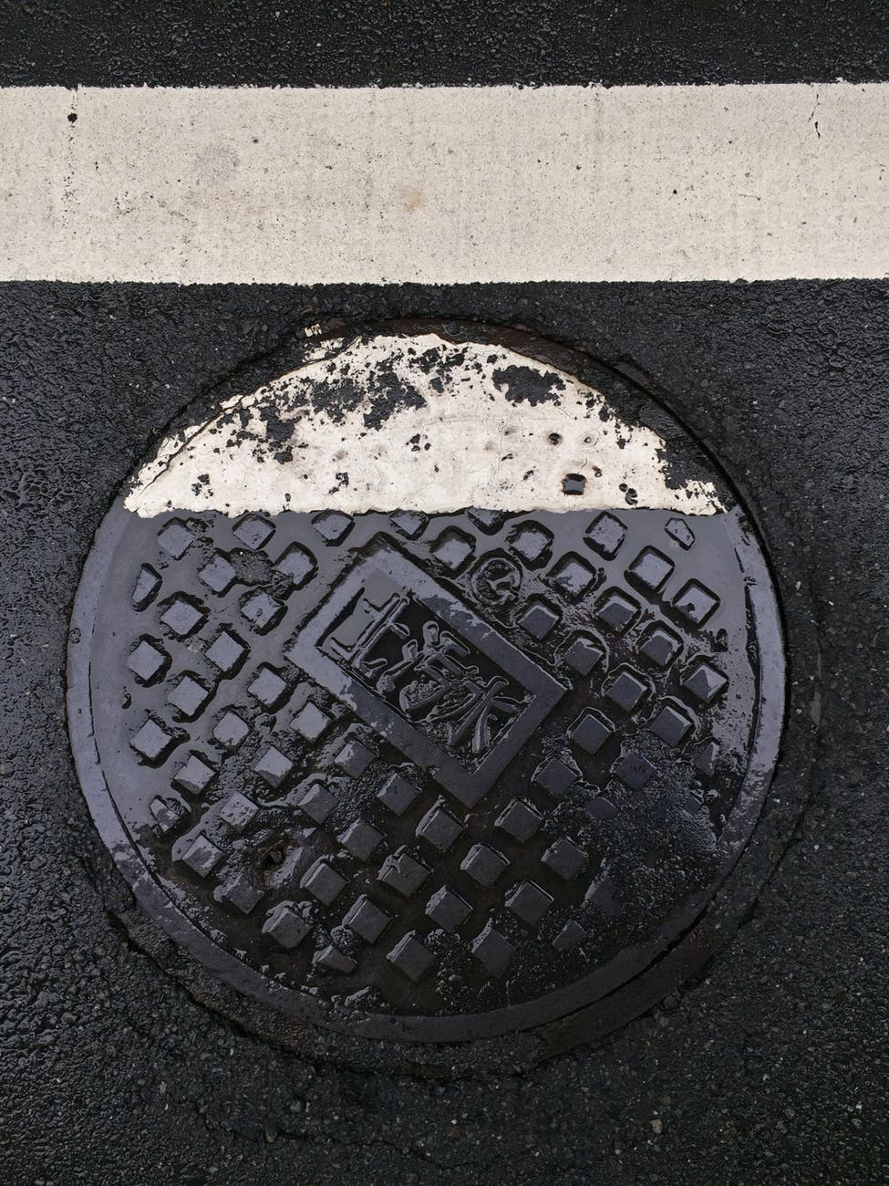 photo of sewer on road