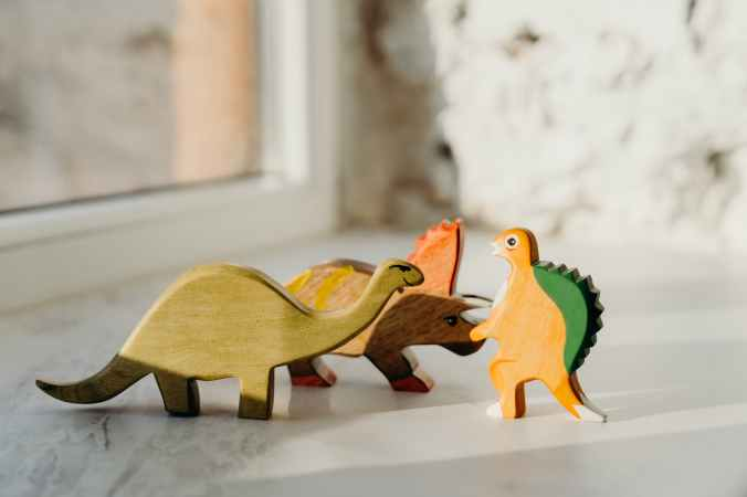 brown wooden animal figurines on white table