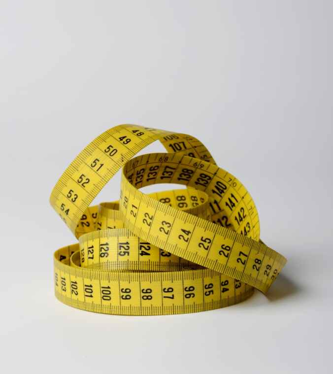 close up photo of yellow tape measure